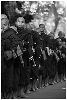 Monks lining up with alms bowls, Mahagandayon Monastery. Amarapura, Myanmar ( black and white)