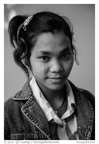 Woman with blue jeans jacket and thanaka paste. Mandalay, Myanmar (black and white)
