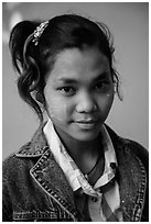 Woman with blue jeans jacket and thanaka paste. Mandalay, Myanmar ( black and white)