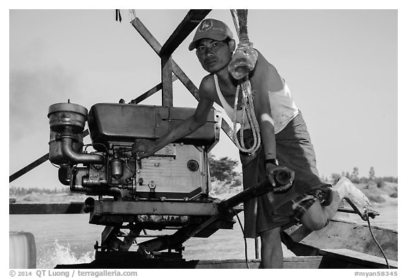Boatman with one cylinder engine, Ava. Myanmar (black and white)