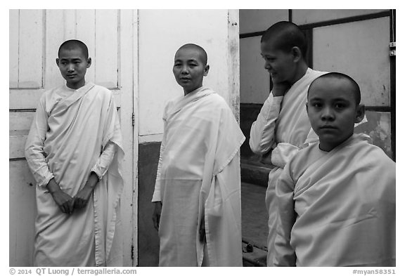 Nuns and pastel walls, Zayar Theingi Nunnery, Sagaing. Myanmar (black and white)