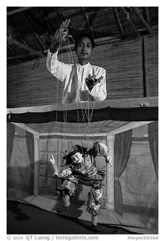 Puppeter handling traditional burmese string marionette. Mandalay, Myanmar (black and white)