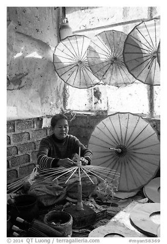 Woman assembling the paper umbrellas carried by the monks. Pindaya, Myanmar (black and white)