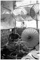 Woman assembling the paper umbrellas carried by the monks. Pindaya, Myanmar ( black and white)