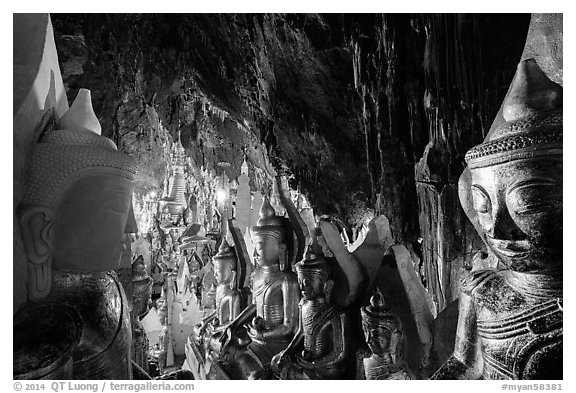 Buddha statues and stalactites in Pindaya Caves. Pindaya, Myanmar (black and white)