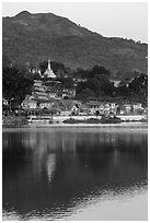 Hill and town reflected in Pone Tanoke Lake at dawn. Pindaya, Myanmar ( black and white)