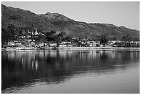 Hill and town reflected in Pone Tanoke Lake at sunrise. Pindaya, Myanmar ( black and white)