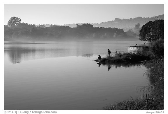 Men on shore of Pone Tanoke Lake. Pindaya, Myanmar (black and white)