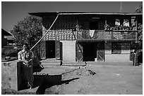 Woman in front of house. Pindaya, Myanmar ( black and white)