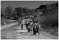 Women walking on road. Shan state, Myanmar ( black and white)