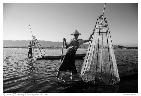 Intha fishermen with conical baskets in warm afternoon light. Inle Lake, Myanmar (black and white)