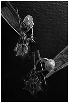 Intha fishermen use spear to stir weed and expose fish. Inle Lake, Myanmar ( black and white)