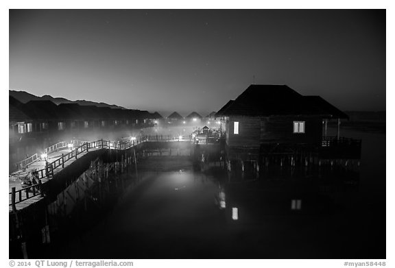 Cottages on stilts at dawn, Myanmar Treasure Resort. Inle Lake, Myanmar (black and white)
