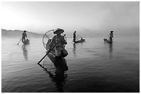 Group of Intha fishermen at dawn with surface mist. Inle Lake, Myanmar ( black and white)