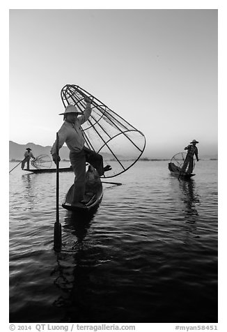 Group of Intha fishermen at dawn. Inle Lake, Myanmar (black and white)