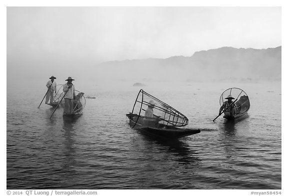 Group of Intha fishermen on misty waters. Inle Lake, Myanmar (black and white)