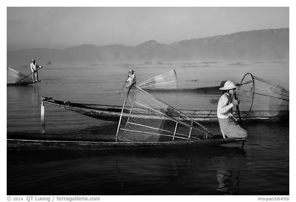 Intha fishermen with conical baskets in morning mist. Inle Lake, Myanmar (black and white)