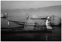 Intha fishermen with conical baskets in morning mist. Inle Lake, Myanmar ( black and white)