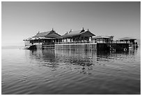 Restaurant built on stilts in middle of lake. Inle Lake, Myanmar ( black and white)