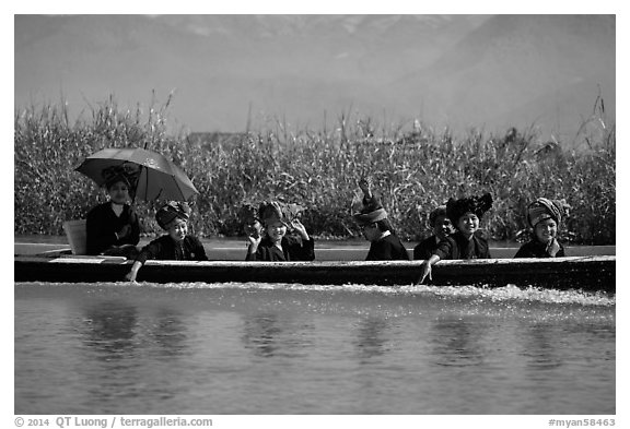 Women with turbans on long tail boat. Inle Lake, Myanmar (black and white)