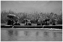 Women with turbans on long tail boat. Inle Lake, Myanmar ( black and white)