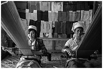 Weaving workshop with Kayan women of the Padaung tribe. Inle Lake, Myanmar ( black and white)