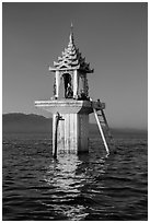Water level marker topped by shrine. Inle Lake, Myanmar ( black and white)