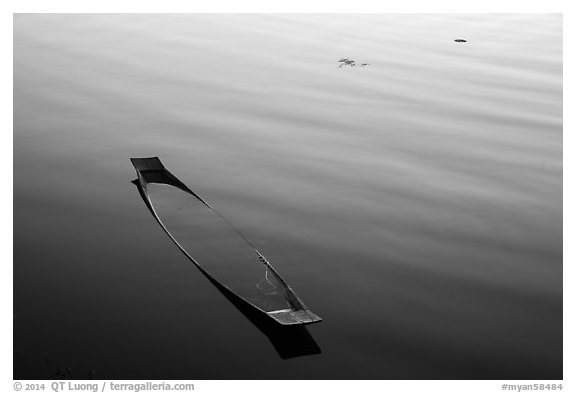 Sunken canoe and ripples. Inle Lake, Myanmar (black and white)