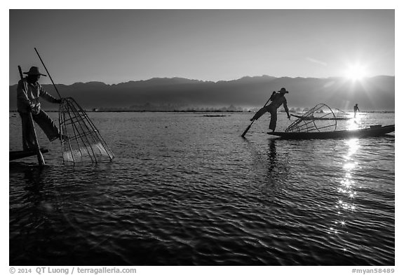 Intha fishermen and sun. Inle Lake, Myanmar (black and white)