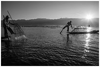 Intha fishermen and sun. Inle Lake, Myanmar ( black and white)