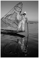 Intha fisherman with freshly caught fish in basket. Inle Lake, Myanmar ( black and white)