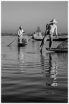 Intha fishermen and reflections. Inle Lake, Myanmar ( black and white)