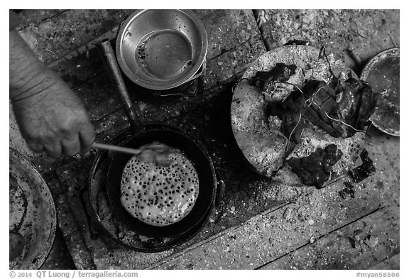 Pancackes cooked on coals. Inle Lake, Myanmar (black and white)