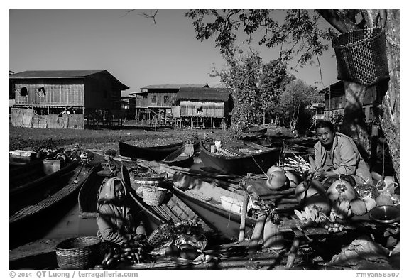 Market, boats, and village houses on stilts. Inle Lake, Myanmar (black and white)