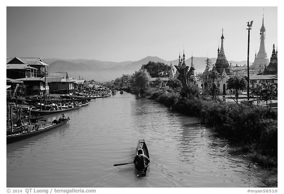 Boats and stupas bordering Ywama Village canal. Inle Lake, Myanmar (black and white)