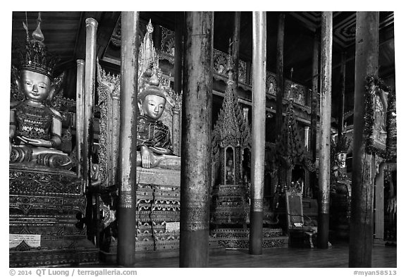 Old wood sculptures inside Nga Phe Kyaung monastery. Inle Lake, Myanmar (black and white)