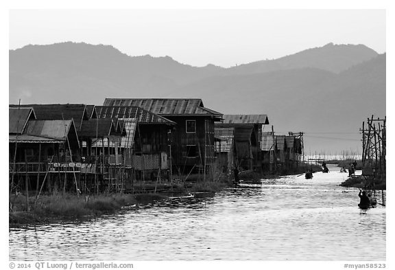 Houses and canal at sunset, Maing Thauk Village. Inle Lake, Myanmar (black and white)