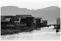 Houses and canal at sunset, Maing Thauk Village. Inle Lake, Myanmar ( black and white)