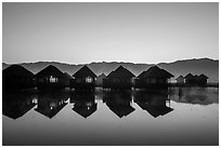 Cottages on stilts at dawn. Inle Lake, Myanmar ( black and white)