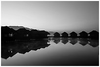 Resort cottages at dawn. Inle Lake, Myanmar ( black and white)