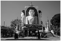 Four buddhas sitting back to back to four directions, Kyaik Pun Pagoda. Bago, Myanmar ( black and white)