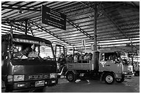 Busses and sign at base station. Kyaiktiyo, Myanmar ( black and white)