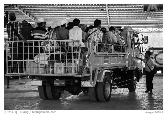 Bus leaving base station with 35 passengers in the back. Kyaiktiyo, Myanmar (black and white)