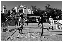 Young men play chin lone (kick volleyball) at Yatetaung. Kyaiktiyo, Myanmar ( black and white)