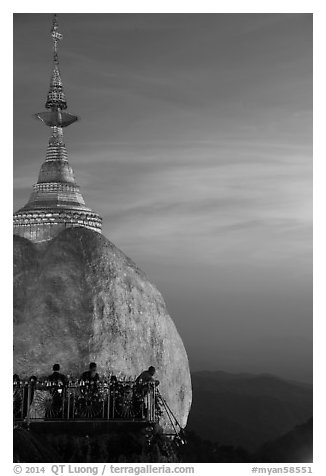 Sunset colors the sky above the Golden Rock. Kyaiktiyo, Myanmar (black and white)