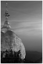 Sunset colors the sky above the Golden Rock. Kyaiktiyo, Myanmar ( black and white)