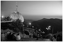 Platforms around the Golden Rock at sunset. Kyaiktiyo, Myanmar ( black and white)