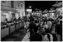 Food vendors and souvenir shops at night, Potemkin village. Kyaiktiyo, Myanmar ( black and white)