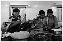 Food vendors reading, Potemkin village. Kyaiktiyo, Myanmar ( black and white)