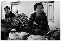 Women at street food stalls, Potemkin village. Kyaiktiyo, Myanmar ( black and white)